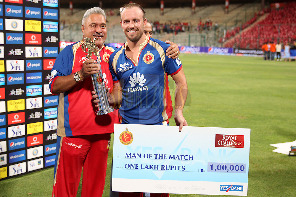 AB de Villiers of the Royal Challengers Bangalore won man of the match award during match 24 of the Pepsi Indian Premier League Season 2014 between the Royal Challengers Bangalore and the Sunrisers Hyderabad held at the M. Chinnaswamy Stadium, Bangalore, India on the 4th May  2014Photo by Prashant Bhoot / IPL / SPORTZPICSImage use subject to terms and conditions which can be found here:  http://sportzpics.photoshelter.com/gallery/Pepsi-IPL-Image-terms-and-conditions/G00004VW1IVJ.gB0/C0000TScjhBM6ikg
