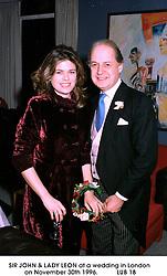 SIR JOHN & LADY LEON at a wedding in London on November 30th 1996.<br /> LUB 18