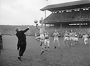 Bishop throws the ball in at the beginning of the All Ireland Senior Gaelic Football final Dublin vs Derry in Croke Park on 28th September 1958. Dublin 2-12 Derry 1-9.