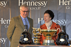 MAURICE HENNESSY and HRH The PRINCESS ROYAL at the 2013 Hennessy Gold Cup at Newbury Racecourse, Berkshire on 30th November 2013.