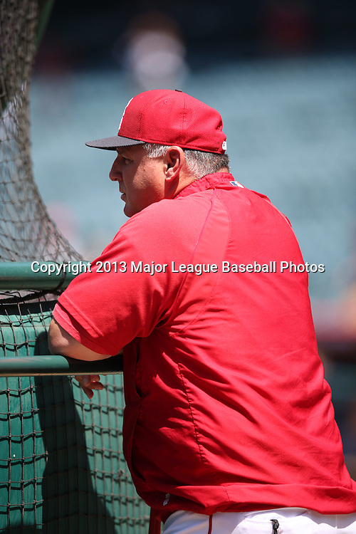 ANAHEIM, CA - JUNE 15:  Mike Scioscia #14 of the Los Angeles Angels of Anaheim watches batting practice before the game against the New York Yankees on Saturday, June 15, 2013 at Angel Stadium in Anaheim, California. The Angels won the game 6-2. (Photo by Paul Spinelli/MLB Photos via Getty Images) *** Local Caption *** Mike Scioscia
