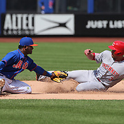 Ivan De Jesus Jr. Cincinnati Reds, is caught stealing second by Dilson Herrera, New York Mets in the Mets 2-1 win in 13 innings during the New York Mets Vs Cincinnati Reds MLB regular season baseball game at Citi Field, Queens, New York. USA. 28th June 2015. Photo Tim Clayton
