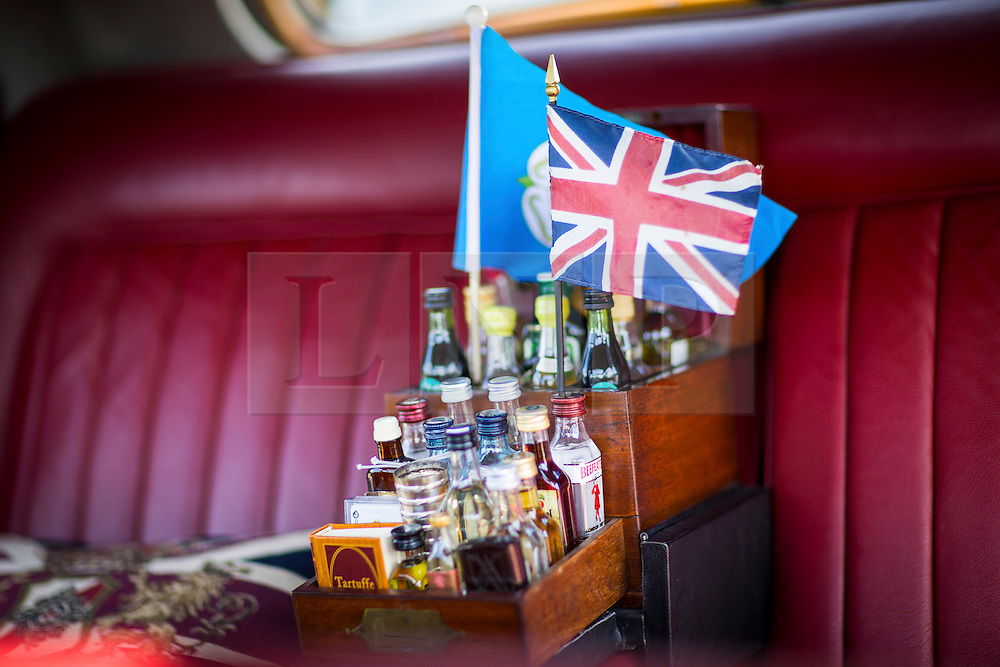© Licensed to London News Pictures. 07/08/2016. Leeds UK. Picture shows the drinks cabinet in a 1953 4.5 Ltr Rolls Royce Silver Dawn at the 37th Rolls Royce North rally that has taken place this weekend in the ground's of Harewood House in Yorkshire. The event bring's together some of the UK's most prized motor cars & their proud owners. Photo credit: Andrew McCaren/LNP