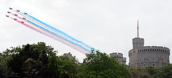© Licensed to London News Pictures. 19/05/2012. WIndsor, UK The Red Arrows fly above Windsor Castle. Armed Forces muster and parade in Windsor today , 19th May 2012, in tribute to Her Majesty the Queen for the Diamond Jubilee. 2,500 troops paraded through the town before the Queen and Duke of Edinburgh to mark the Diamond Jubilee. Once the parade has passed the Queen and Duke traveled along the same route to an arena within Home Park, where the troops mustered. A tri-service flypast of 78 aircraft, including helicopters, Hawks, the Battle of Britain Memorial Flight, the Red Arrows and Tornados went overhead. Photo credit : Stephen Simpson/LNP