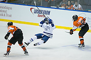 RIT defenseman Chase Norrish takes down Air Force forward Ben Carey during the Atlantic Hockey semifinal at the Blue Cross Arena at the War Memorial in Rochester on Friday, March 18, 2016.