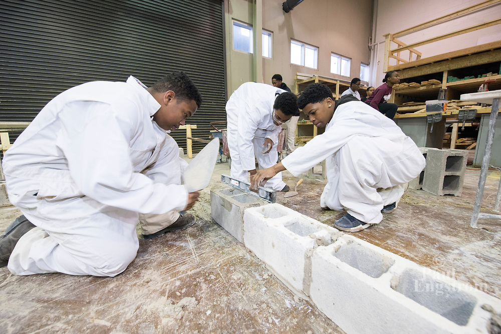 Carpentry and masonry featured in half-day high school program while building the foundation of a Tiny House at A. Randolph Technical Center, a trades prep school in Detroit.