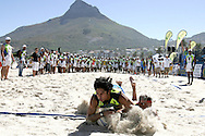 Camps Bay, Players battle for the ball in a 30 meter run off after tying a game during the Oasis SKW Camps Bay Beach Touch Rugby Tournament held on the 2 February 2008, Cape Town, South Africa...Image © Sportzpics