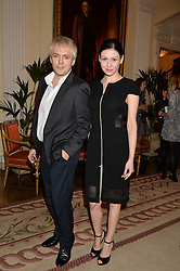 NICK RHODES and NEFER SUVIO at a party hosed by the US Ambassador to the UK Matthew Barzun, his wife Brooke Barzun and editor of UK Vogue Alexandra Shulman in association with J Crew to celebrate London Fashion Week held at Winfield House, Regent's Park, London on 16th September 2014.