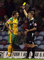 Photo: Paul Thomas.<br /> Burnley v Norwich City. Coca Cola Championship. 23/10/2007.<br /> <br /> Darren Huckerby (L) of Norwich gets a yellow card from referee Mr Jones.