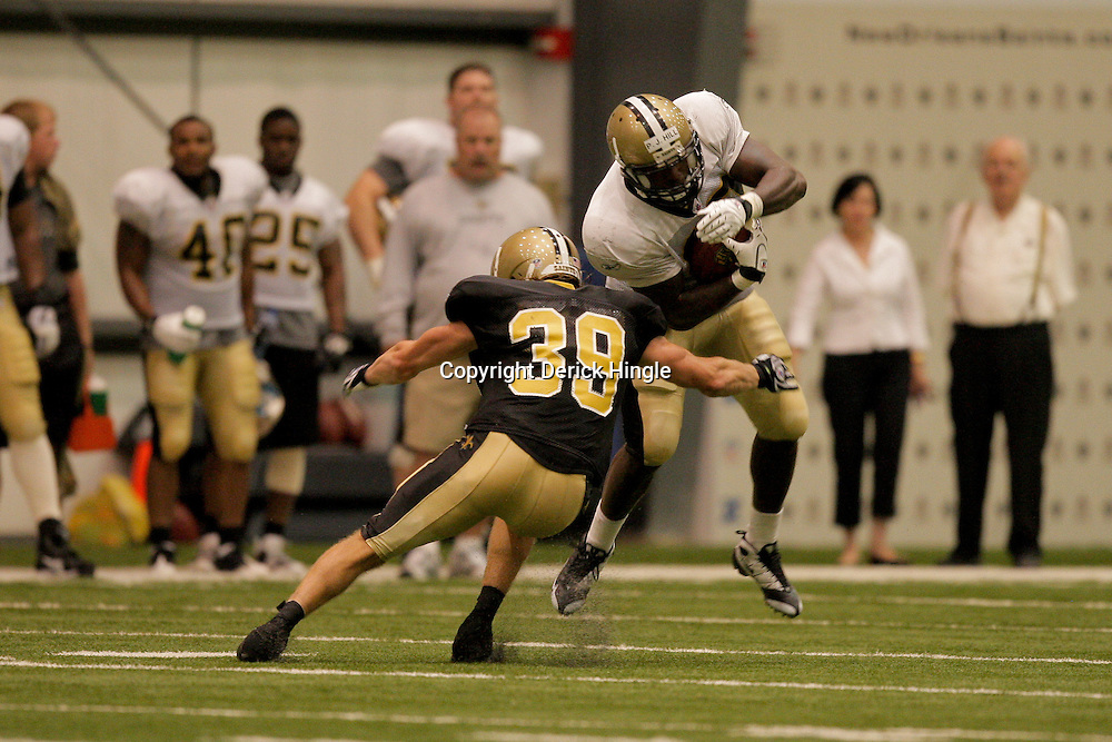 08 August 2009: Safety Chris Reis (39) tackles rookie running back P.J. Hill (43) during the New Orleans Saints annual training camp Black and Gold scrimmage held at the team's indoor practice facility in Metairie, Louisiana.