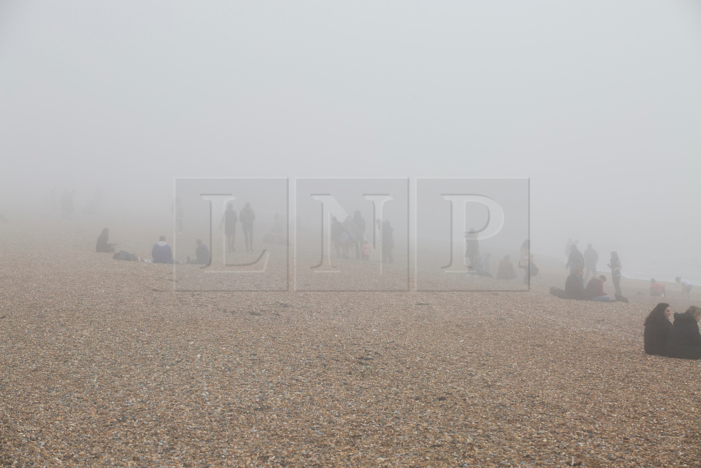 © Licensed to London News Pictures. 11/03/2017. Brighton, UK. A thick cloud of fog hangs over Brighton and Hove beach hiding the Brighton Palace Pier from view. Photo credit: Hugo Michiels/LNP