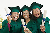 Smiling Graduates Holding Their Degrees