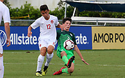 Slovenia defender Peter Ceferin (3) tackles and kicks the ball away from Canada forward Marko Stojadinovic (12) during a CONCACAF boys under-15 championship soccer game, Saturday, August 10, 2019, in Bradenton, Fla. Slovenia defeated Canada in 2-1 in overtime and advanced to the finals against Portugal. (Kim Hukari/Image of Sport)