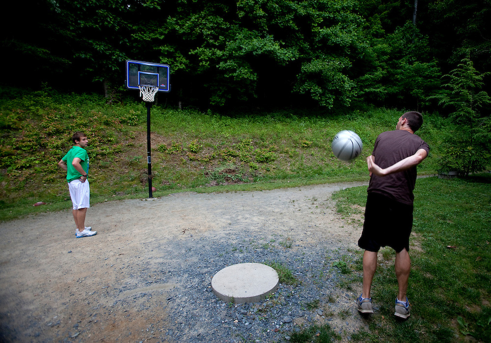 Zap Fitness athletes Cole Atkins and Dave Jankowski shoot some hoops during down time at the training center..