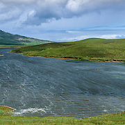 Loch Leathan overlooking the Trotternish ridge, Isle of Skye