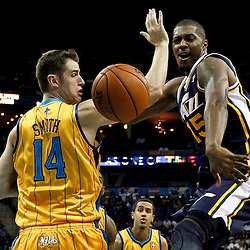 November 2, 2012; New Orleans, LA, USA; Utah Jazz power forward Derrick Favors (15) loses the ball as New Orleans Hornets power forward Jason Smith (14) defends during the first quarter of a game at the New Orleans Arena. Mandatory Credit: Derick E. Hingle-USA TODAY SPORTS