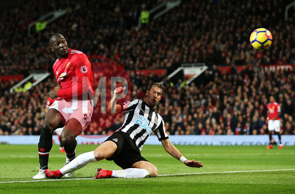 Romelu Lukaku of Manchester United fires a shot at goal under pressure from Florian Lejeune of Newcastle United  - Mandatory by-line: Matt McNulty/JMP - 18/11/2017 - FOOTBALL - Old Trafford - Manchester, England - Manchester United v Newcastle United - Premier League