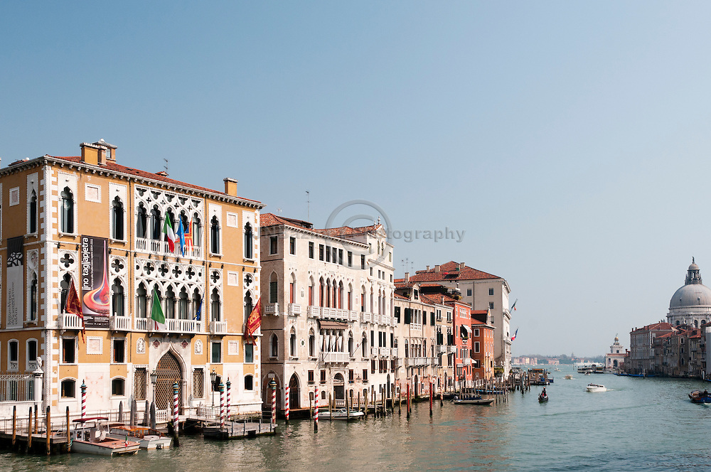 The institute of science on the Grand Canal as seen from the Ponte dell Accademia, Venice Italy.