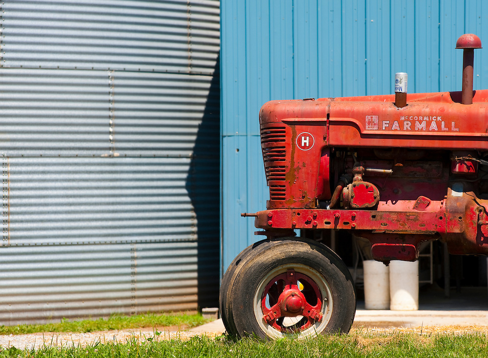 Tractor outside silos