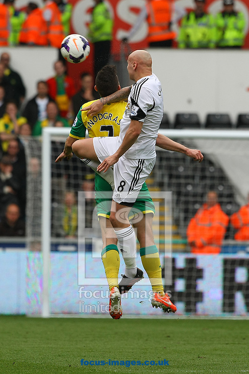 Robert Snodgrass of Norwich and Jonjo Shelvey of Swansea in action during the Barclays Premier League match at the Liberty Stadium, Swansea<br /> Picture by Paul Chesterton/Focus Images Ltd +44 7904 640267<br /> 29/03/2014