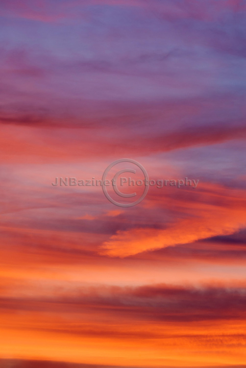 Dusk reveals warm, vivid colors in the sky; creating an abstract form