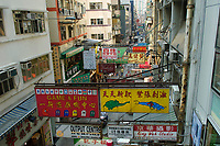 Side street with Chinese advertising signs from the Central to Mid level escalator Hong Kong Hong Kong August 2008