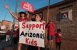 April 25, 2018 - Tucson, Arizona, U.S - Hundreds of Tucson teachers came out onto the streets demanding higher wages and an increase in funding for schools on the day before a state wide walk out by Arizona teachers. A huge majority voted to strike unless Governor Ducey and the state legislature meet their demands. Arizona teacchers are some of the lowest paid in the nation scoring near the botton in salaries and state funding for public schools.The protest was held to gain support from the public. Most school districts in Tucson have announced they will close until at least the end of the week. (Credit Image: © Christopher Brown via ZUMA Wire)