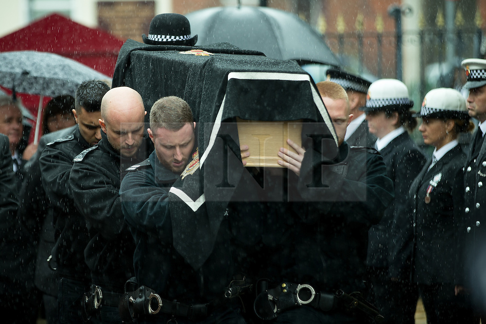 © Licensed to London News Pictures . 15/07/2016 . Bolton , UK . The coffin is carried in to the church . The funeral of Special Constable Samantha Derbyshire at St Mary's RC Church in Horwich , Bolton. Derbyshire was struck and killed by an HGV on the M61 motorway following a collision , in the early hours of Monday 11th July 2016 . Photo credit : Joel Goodman/LNP