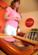 Penny Walters stands behind a picture of her son, Matt Jones, who died a year earlier on July 30, 2004 of a cocaine overdose.  Photo by Elliot Knight