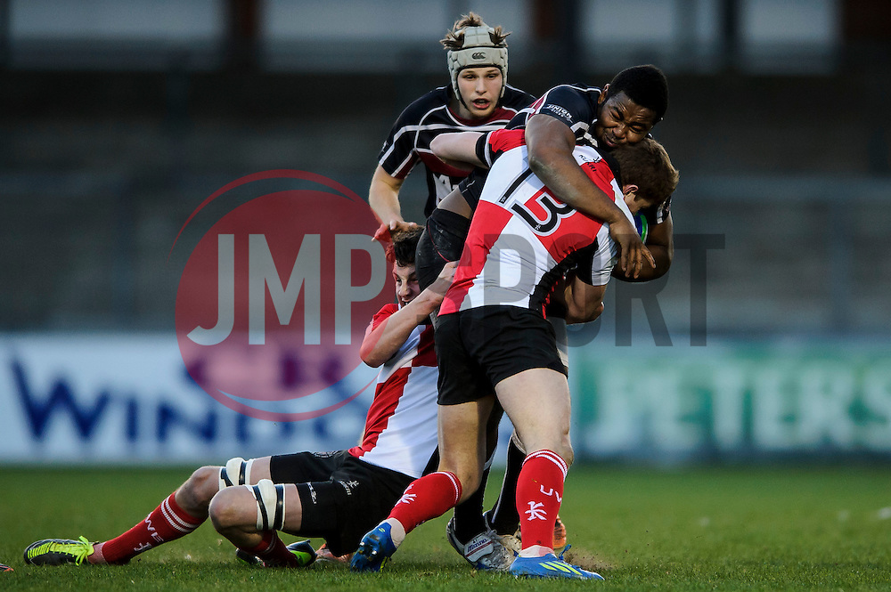 University of Bristol Prop (#1) Joshua Leslie  is tackled by UWE Lock (#4) Rob Weston and Centre (#13) Tom Hodge  during the first half of the match - Photo mandatory by-line: Rogan Thomson/JMP - Tel: Mobile: 07966 386802 - 29/04/2013 - SPORT - RUGBY - Memorial Stadium - Bristol. University of Bristol v University of the West of England - 2013 edition of the annual Rugby Union University Varsity match in Bristol.