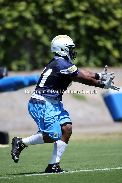 San Diego Chargers defensive end Damion Square (71) catches a pass during the San Diego Chargers Spring 2015 NFL minicamp practice held on Tuesday, June 16, 2015 in San Diego. (©Paul Anthony Spinelli)
