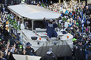 Marshawn Lynch throws Skittles to the crowd at a huge downtown parade celebrating the Seahawks' first Super Bowl title.<br /> Ellen M. Banner / The Seattle Times