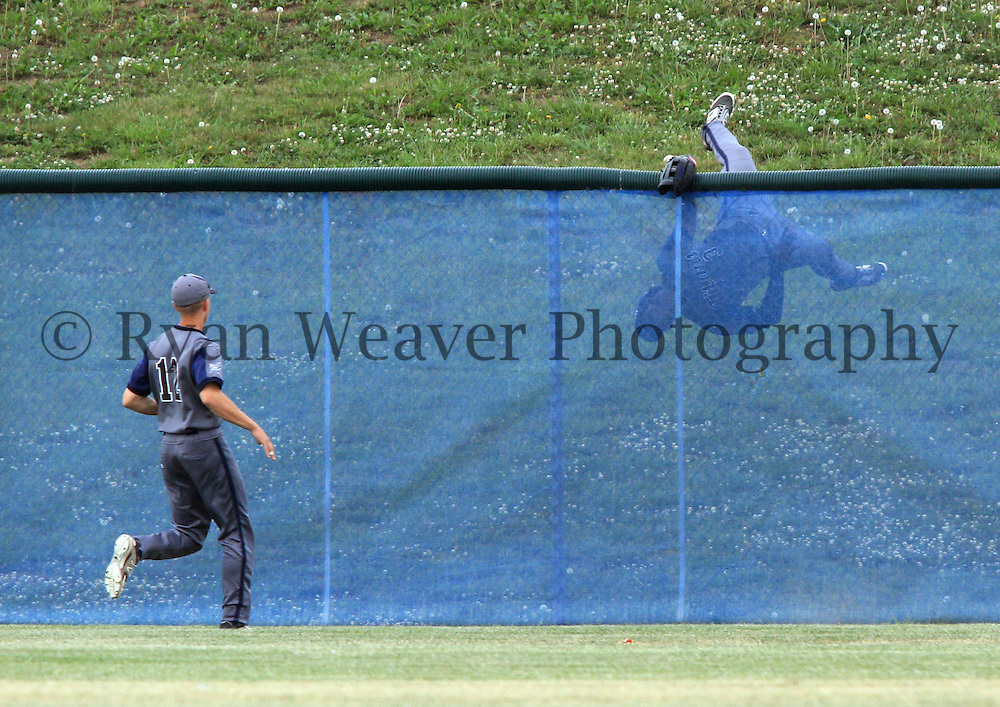 Monte Harrison of Lee's Summit West goes over the center field fence trying to catch Colton Pogue's three-run home run in the top of the first inning. Blue Springs South put up eight runs in the first two innings, enough to beat the Titans 13-5 in a Class 5 sectional game.