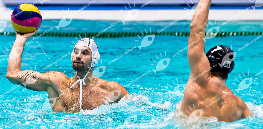 Eindhoven , Netherlands (NED) 16 - 29 January 2012.LEN European  Water Polo Championships 2012.Day 06 - Men.SRB (White) - ROU (Blue)..SRB.9 RADJEN Nikola.ROU.7 MATEI GUIMAN Alexandru..Photo G.Scala/Deepbluemedia.eu