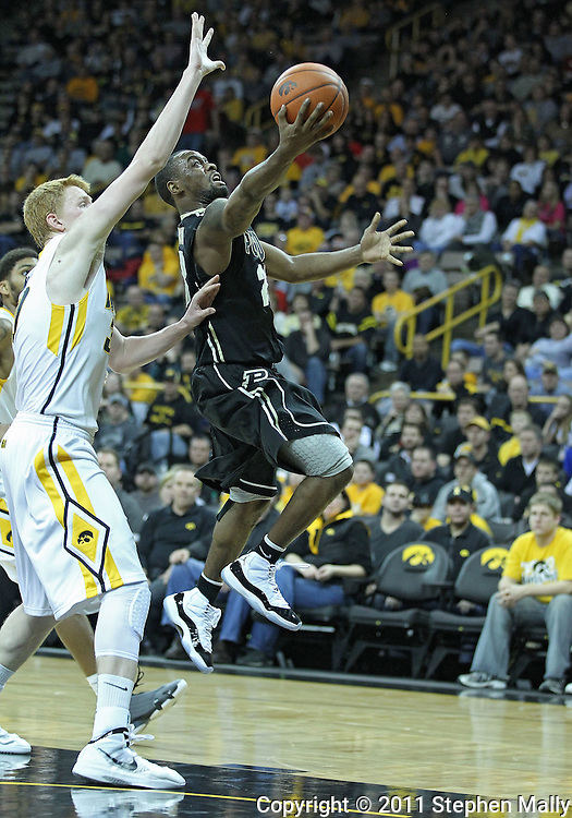December 28, 2011: Purdue Boilermakers guard Lewis Jackson (23) puts up a shot over Iowa Hawkeyes forward Aaron White (30) during the NCAA basketball game between the Purdue Boilermakers and the Iowa Hawkeyes at Carver-Hawkeye Arena in Iowa City, Iowa on Wednesday, December 28, 2011. Purdue defeated Iowa 79-76.