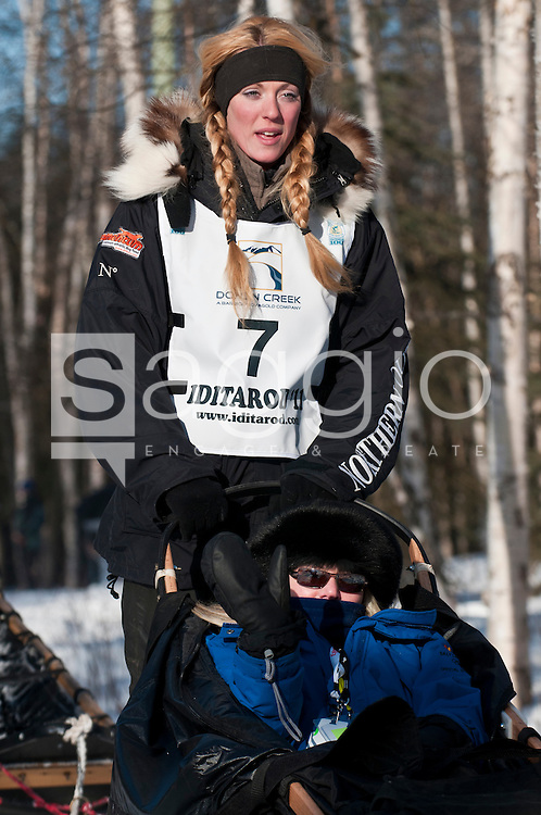 Musher Kristy Berington and Iditarider Sherry Lesar stroll along the Chester Creek Trail during the 2011 Iditarod Ceremonial Start.