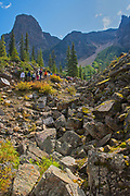 Hikers on The Rock Pile at the east end of Moraine Lake<br />