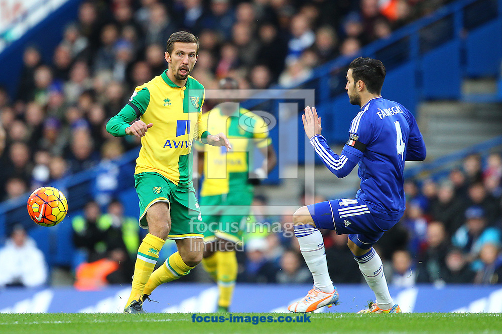 Gary O&rsquo;Neil of Norwich and Cesc F&agrave;bregas of Chelsea in action during the Barclays Premier League match at Stamford Bridge, London<br /> Picture by Paul Chesterton/Focus Images Ltd +44 7904 640267<br /> 21/11/2015