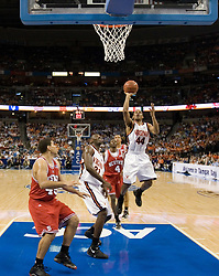 Virginia Cavaliers point guard Sean Singletary (44) gets a first half shot off against NC State.  The Virginia Cavaliers Men's Basketball Team fell to the North Carolina State Wolfpack 76-71 in the quarterfinal round of the 54th ACC Tournament at the St. Pete's Times Forum in Tampa, FL on March 9, 2007.