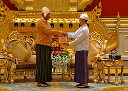 Myanmar's out-going President U Thein Sein (R) hands over president power to newly-elected President of Myanmar U Htin Kyaw (L) at the Presidential Palace in Nay Pyi Taw, Myanmar, March 30, 2016. EXPA Pictures © 2016, PhotoCredit: EXPA/ Photoshot/ Xinhua<br /> <br /> *****ATTENTION - for AUT, SLO, CRO, SRB, BIH, MAZ, SUI only*****