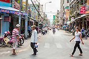 "12 APRIL 2012 - HO CHI MINH CITY, VIETNAM:  Tran Hung Dao Street in Cholon. Cholon is the Chinese-influenced section of Ho Chi Minh City (former Saigon). It is the largest ""Chinatown"" in Vietnam. Cholon consists of the western half of District 5 as well as several adjoining neighborhoods in District 6. The Vietnamese name Cholon literally means ""big"" (lon) ""market"" (cho). Incorporated in 1879 as a city 11 km from central Saigon. By the 1930s, it had expanded to the city limit of Saigon. On April 27, 1931, French colonial authorities merged the two cities to form Saigon-Cholon. In 1956, ""Cholon"" was dropped from the name and the city became known as Saigon. During the Vietnam War (called the American War by the Vietnamese), soldiers and deserters from the United States Army maintained a thriving black market in Cholon, trading in various American and especially U.S Army-issue items.         PHOTO BY JACK KURTZ"
