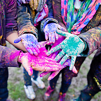 London, UK - 23 March 2013: painted hands during the Holi Spring Festival of Colour takes place at Orleans House Gallery in Twickenham. The annual event marks the end of Winter and welcomes the joy of spring.