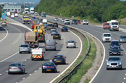 ©Licensed to London News Pictures 23/06/2020<br /> Swanley, UK. M25 traffic this afternoon near junction three for Swanley in Kent at 4pm. Traffic on the roads has started to increase as the restrictions from coronavirus lockdown are lifted. Photo credit: Grant Falvey/LNP