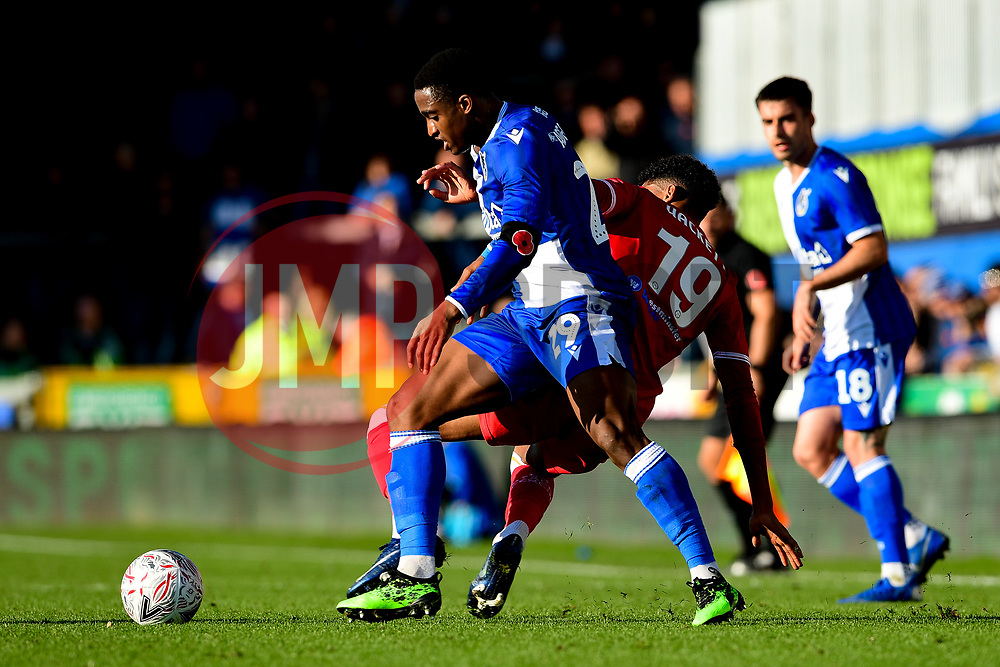 Victor Adeboyejo of Bristol Rovers is challenged by Recco Hackett-Fairchild of Bromley - Mandatory by-line: Ryan Hiscott/JMP - 10/11/2019 - FOOTBALL - Memorial Stadium - Bristol, England - Bristol Rovers v Bromley - Emirates FA Cup first round