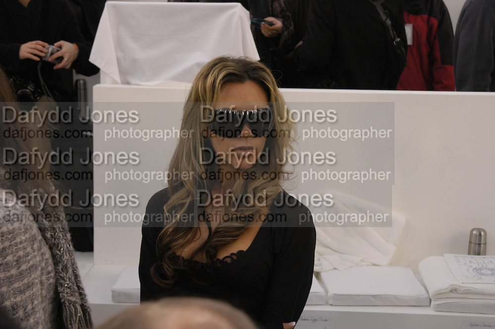Victoria Beckham. Chanel couture fashion show. Grand Palais, Ave Winston Churchill. Paris. 24  January  2006.  ONE TIME USE ONLY - DO NOT ARCHIVE  © Copyright Photograph by Dafydd Jones 66 Stockwell Park Rd. London SW9 0DA Tel 020 7733 0108 www.dafjones.com