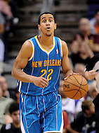 Apr 7, 2013; Phoenix, AZ, USA; New Orleans Hornets guard Brian Roberts (22) dribbles the ball up the court in the second half of the game against the Phoenix Suns at US Airways Center. The Hornets defeated the Suns 95-92. Mandatory Credit: Jennifer Stewart-USA TODAY Sports.