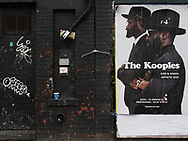 Graffiti and a poster of The Kooples on West 39th street.