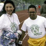 Down Syndrome Special Olympics athlete before the competition with his volunteer coach