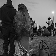 Refugees at the border between Italy and France, near Ventimiglia, praying in the first Ramadn evening. Since 5 days they are staying on the rocks just near the border, as they want to pass in France that closed the doors.