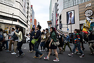 Protesters hold placards demanding a higher wage in Tokyo April 15, 2017, Japan. A Group of young people named Aequitas who means Equity in Latin, organised a demonstration to demanded a minimum hourly wage of 1,500 JPY (approx. USD 13.7), currently the minimum wage ranges from 700 to 900 JPY (approx. USD from 6,4 to 8,3). 15/04/2017-Tokyo, JAPAN